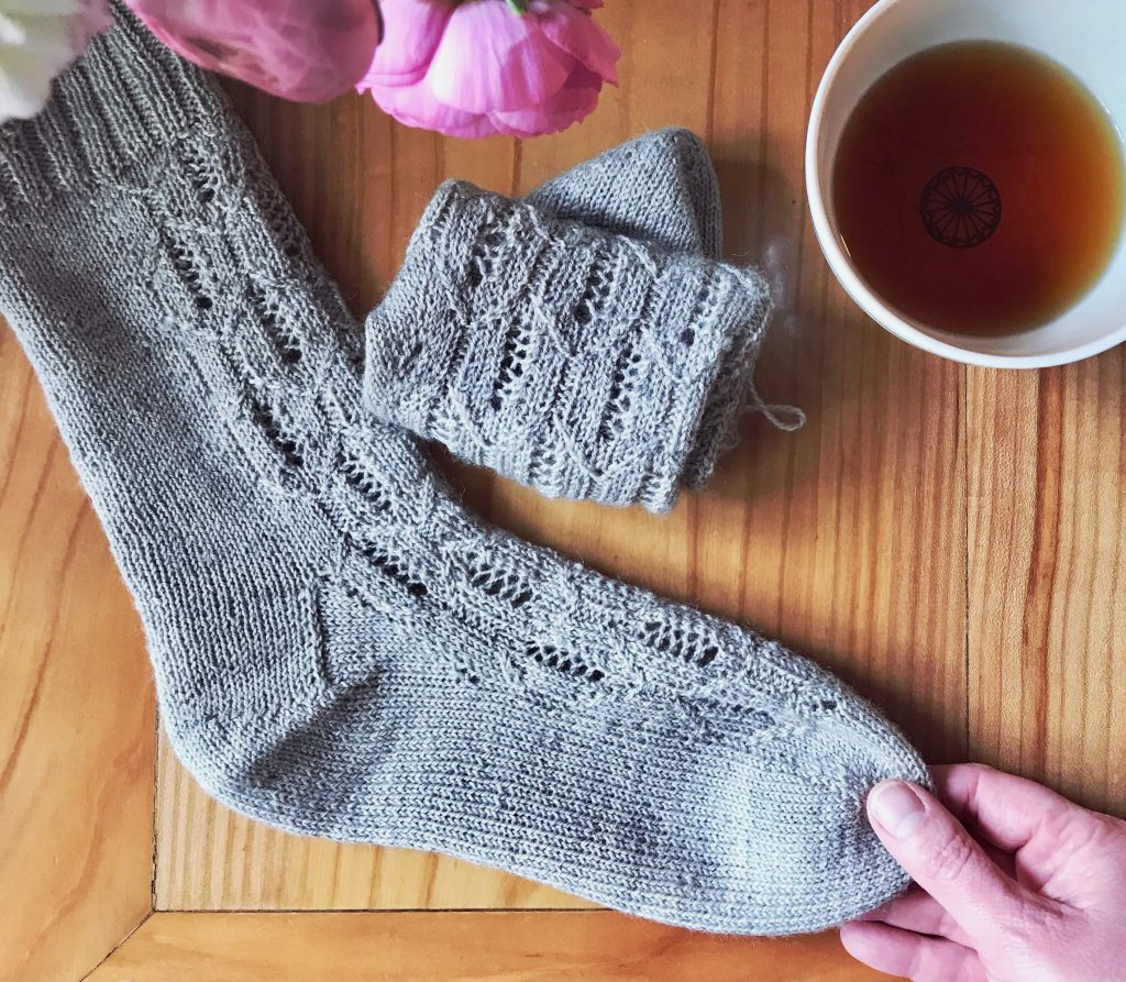 Flatlay of Morningside Socks and a cup of tea.