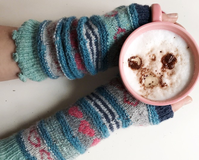 Knitting mitts, drinking coffee