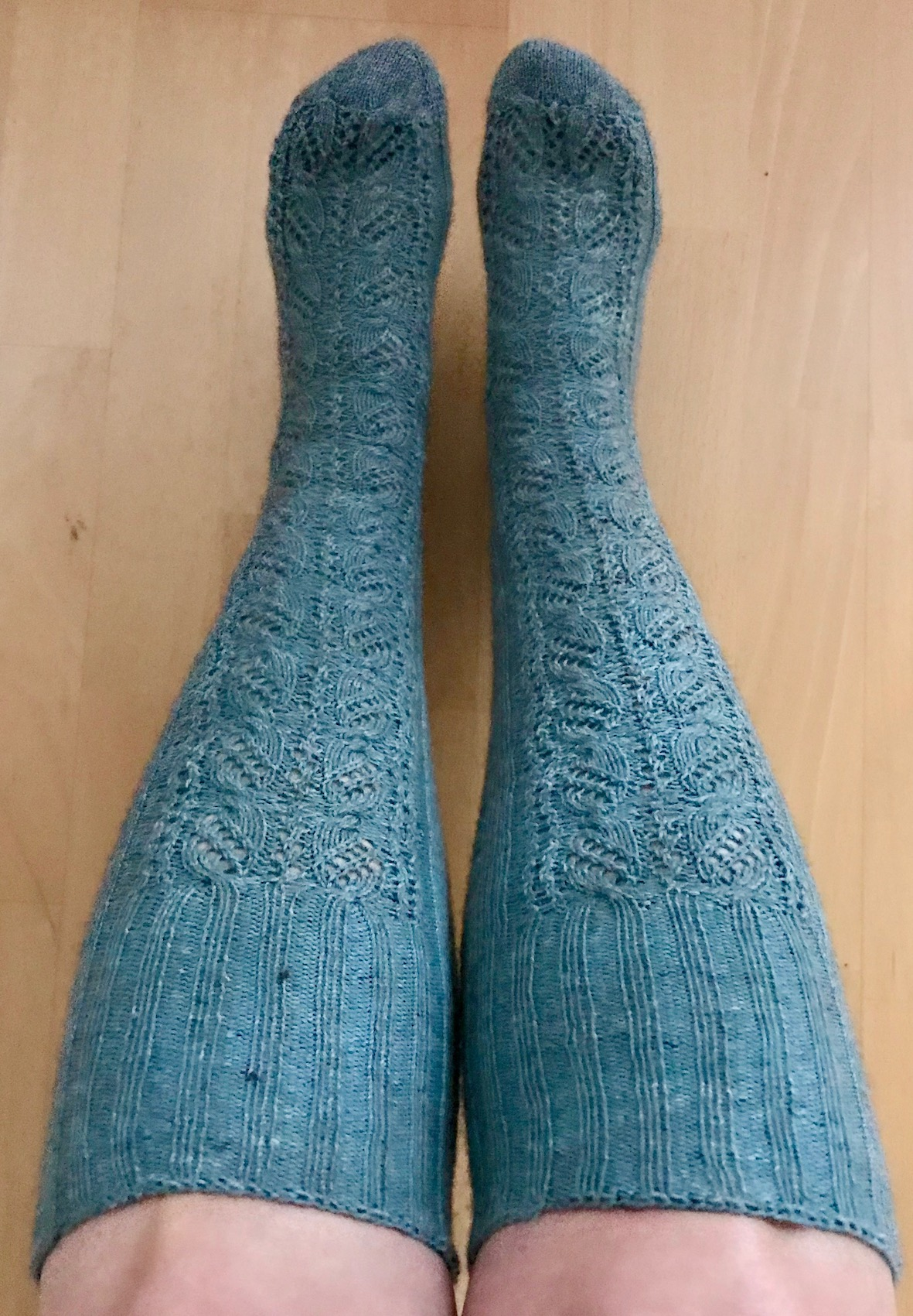 Knitted knee-high socks on bigger calves to show size inclusion